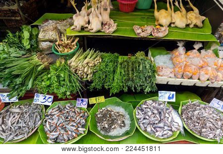 Fish, chicken and herbs on the local market in Thailand