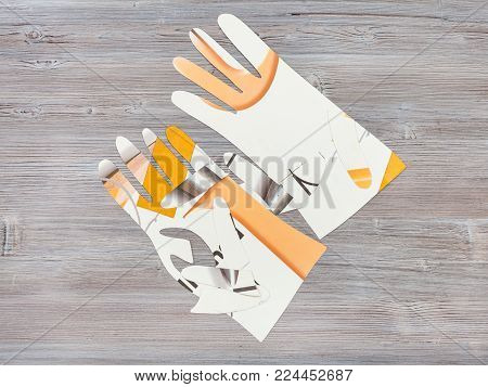 workshop on sewing gloves - top view of paper models of gloves on wooden table