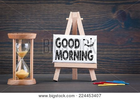Good morning. Sandglass, hourglass or egg timer on wooden table showing the last second or last minute or time out
