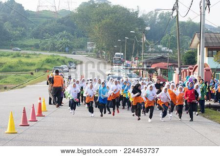 Kuala Lumpur, Malaysia - January 20, 2018: Group Of Primary School Athletes Running A Cross Country