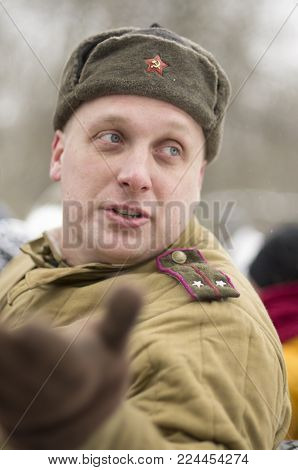 St. Petersburg, Russia - February 23, 2017: The Soviet soldier with signs of distinction in celebration of the Day of Defender of the Fatherland. Historical reenactment Second World War.