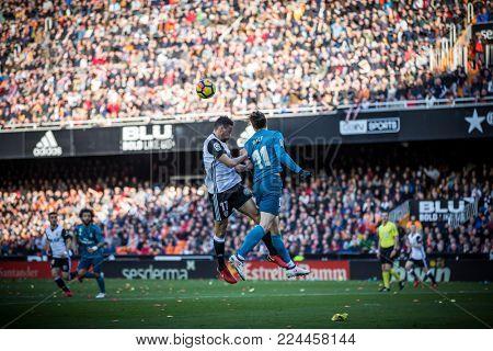 VALENCIA, SPAIN - JANUARY 27: (L) Vezo and Bale during Spanish La Liga match between Valencia CF and Real Madrid at Mestalla Stadium on January 27, 2018 in Valencia, Spain