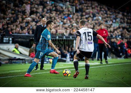 VALENCIA, SPAIN - JANUARY 27: (L) Lucas Vazquez during Spanish La Liga match between Valencia CF and Real Madrid at Mestalla Stadium on January 27, 2018 in Valencia, Spain