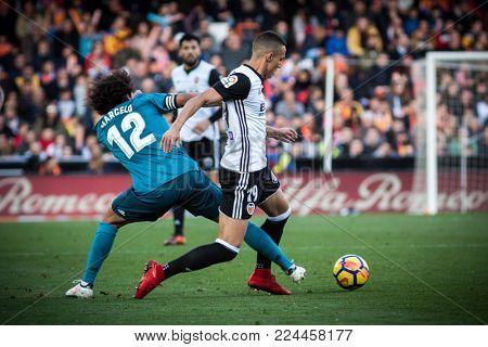 VALENCIA, SPAIN - JANUARY 27: Rodrigo with ball during Spanish La Liga match between Valencia CF and Real Madrid at Mestalla Stadium on January 27, 2018 in Valencia, Spain