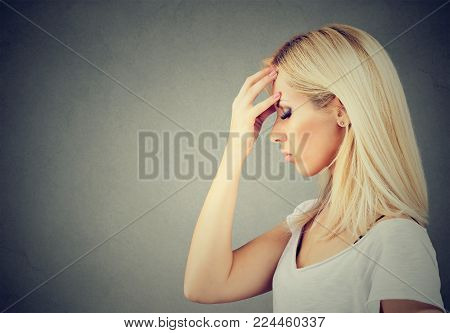 Sorrowful young sad woman thoughtful with worried face expression