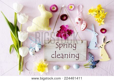 Wooden Sign With English Text Spring Cleaning. Easter Flat Lay With Decoration Like Easter Bunny And Easter Egg. Spring Flower Blossoms Like Tulipa, Daisy And Narcissus.