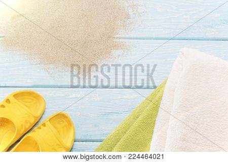 yellow flip flops on white beach sand