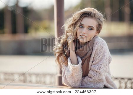 Beautiful Young Woman Outdoors In The Park In Spring.beautiful Young Woman Enjoying Nature Outdoor.