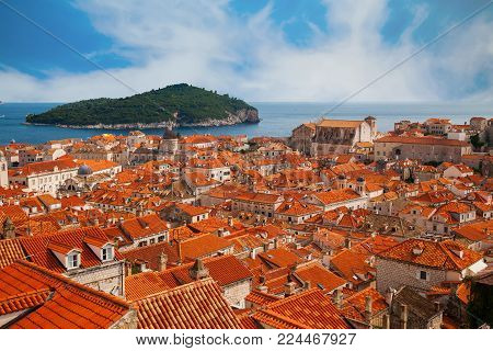 view of Dubrovnik old town and green island Lokrum in a distance, Croatia