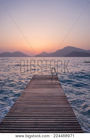 Sundown Fethiye pier seaview. The sea, the mountains and the sky. Pastel colors