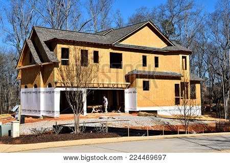 WATKINSVILLE, GEORGIA, USA - JANUARY 30, 2018: Home construction is booming at local counties in Georgia. Shown is a new home being constructed on January 30, 2018 at Watkinsville, Georgia.