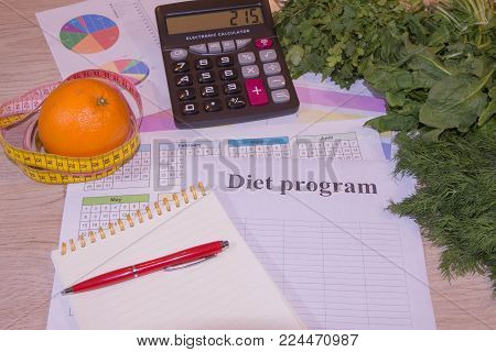 Healthy natural organic food diet, ripe harvest. Fruit composition, measuring tape, calculator with diet plan. Concept diet and weight loss on the table