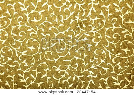 golden handmade art paper with floral pattern