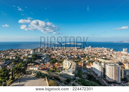 Marseille, France - December 4, 2016: View of Marseille from basilica Notre-Dame de la Garde with the islands and If Castle, Provence, France