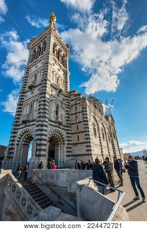 Marseille, France - December 4, 2016: Tourists at the foot of the of Notre Dame de la Garde in Marseille, Provence, France.