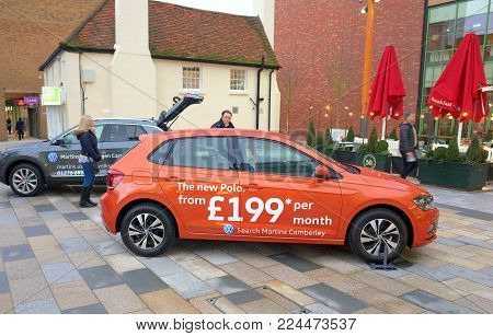 Bracknell, England - January 31, 2018: The new Volkswagen Polo car, accompanied by representatives of a Volkswagen dealership is displayed in the town center of Bracknell, England