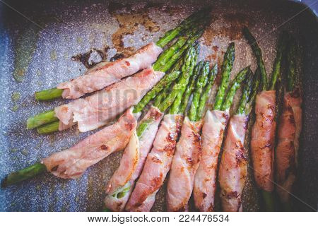 Close Up View Of Asparagus Wrapped In Beacon