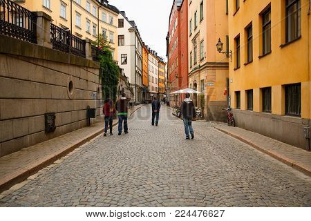 Stockholm, Sweden - August 11, 2014 - Unknown people walking in old town, Gamla Stan.