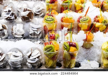 Salad sliced from fresh fruit in a plastic cup