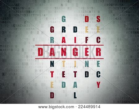 Protection concept: Painted red word Danger in solving Crossword Puzzle on Digital Data Paper background