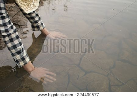 Asian man on nature ,crisis of water drought concept, selective and soft focus