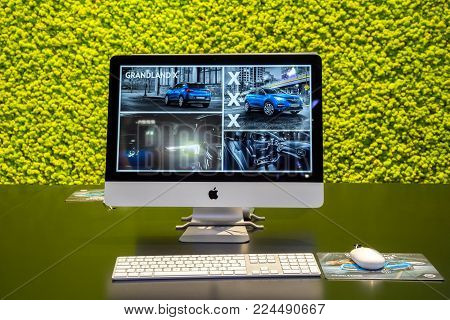 BRUSSELS - JAN 10, 2018: Apple iMac with information about the new Opel Grandland X car shown at the Brussels Motor Show.