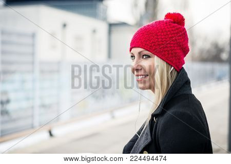 Woman waiting for a suburban train