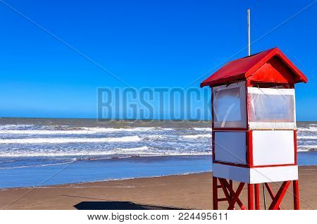 Lifeguards empty stand in Carilo Argentina with blue sky