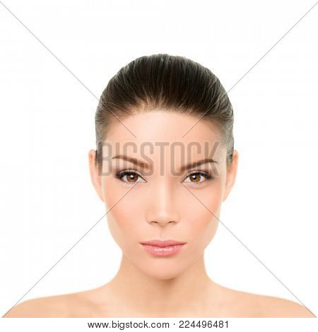 Asian woman beauty face portrait isolated on white background. Head and shoulders of Chinese Caucasian multiracial model girl with makeup and clean smooth skin for facial concept.