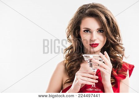 fashionable girl in red dress holding glass of cocktail isolated on white
