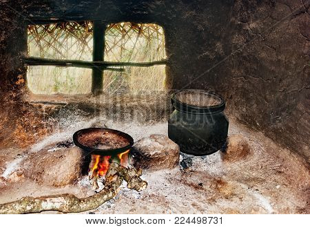 Sri Lanka's poor people's kitchen in the hut. A frying pan and a pot on a primitive cooker