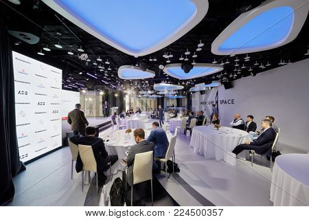 MOSCOW, RUSSIA - OCT 31, 2017: People in Mercury Space hall of Moskva City business complex listen to speaker during annual conference of Kommersant Publishing House.