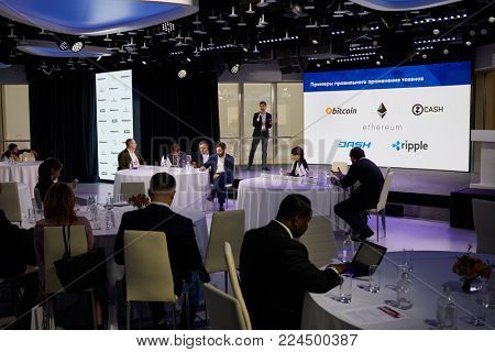 MOSCOW, RUSSIA - OCT 31, 2017: People in Mercury Space hall listen to speaker at annual conference of Kommersant PH on e-commerce, online sales and multichannel networks.