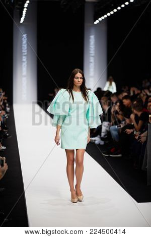 MOSCOW, RUSSIA - OCT 24, 2017: Model on catwalk in Manege during performing designer Nikolay Legenda collection at Mercedes Benz Fashion Week Russia spring-summer 2018.