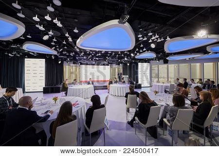 MOSCOW, RUSSIA - OCT 31, 2017: People in Mercury Space hall listen to speaker during annual conference of Kommersant Publishing House on e-commerce, online sales and multichannel networks.