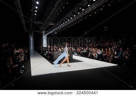 MOSCOW, RUSSIA - OCT 24, 2017: Mercedes Benz Fashion Week Russia spring-summer 2018 day four. Models on catwalk in Manege during performing designer Nikolay Legenda collection.