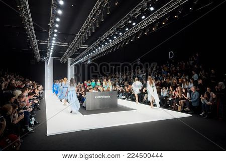 MOSCOW, RUSSIA - OCT 24, 2017: Mercedes Benz Fashion Week Russia spring-summer 2018 day four. Models parade on catwalk in Manege during performing designer Nikolay Legenda collection.