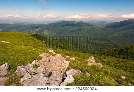 rock formation on an alpine meadow. lovely summer landscape in mountains.