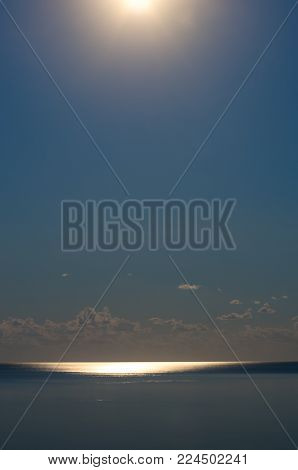 moonlight on the sea, evening. blue sky with clouds. vertical composition.
