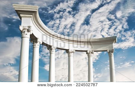 Ancient Greek columns against a blue sky