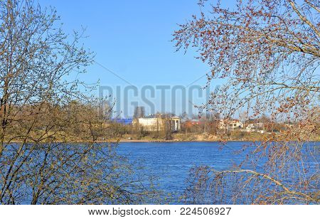 View of Neva River and Lutheran Church of St. Catherine on the outskirts of St. Petersburg at sunny spring day, Russia.