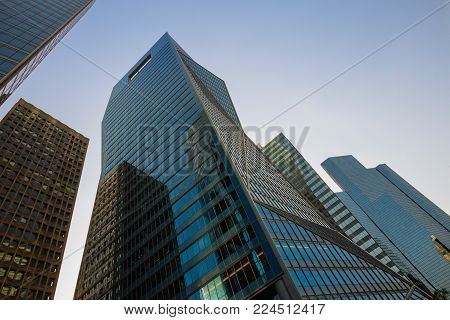 Skyscraper Glass Facades On A Bright Sunny Day. Cityscape With Modern Buildings In Paris Business Di