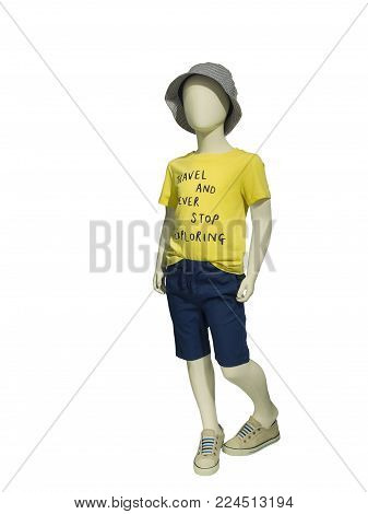 Child mannequin dressed in casual clothes, isolated on white background. No brand names or copyright objects.