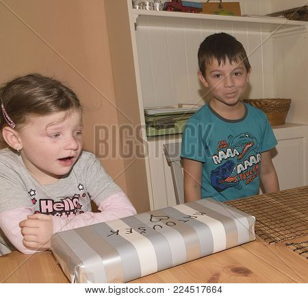 HUSTOPECE, THE CZECH REPUBLIC - JANUARY 13, 2018: Boy celebrating the ninth birthday. Brother and his disappointed sister.