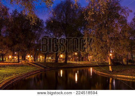 Dusk autumn view of park and pond in Yusupov Garden, Saint Petersburg, Russia