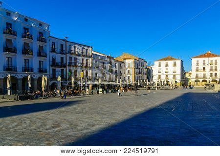 CACERES, SPAIN - DECEMBER 21, 2017: Scene of the Plaza Mayor (main square), with local businesses, locals and visitors, in Caceres, Extremadura, Spain
