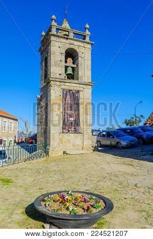 BELMONTE, PORTUGAL - DECEMBER 22, 2017: The tower of Igreja de Santiago e Panteao dos Cabrais church, in Belmonte, Castelo Branco, Portugal