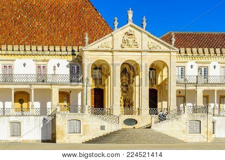 COIMBRA, PORTUGAL - DECEMBER 23, 2017: The Jesus College building in the old university, with visitors, in Coimbra, Portugal