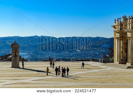 COIMBRA, PORTUGAL - DECEMBER 23, 2017: The old university courtyard, with landscape and visitors, in Coimbra, Portugal