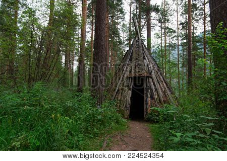 Old hovel of ancient altai people in the forest, Altai, Siberia, Russia
